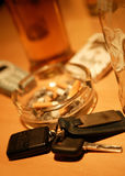 Car keys on pub table with ash tray and alcoholic drink in background Stock Image