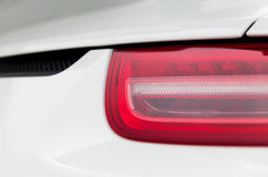 Close up of car part with grille and headlight Stock Images