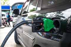 Close up, Car refueling on petrol station. Fuel pump with gasoline Stock Image
