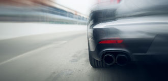 Close up of car riding on highway from back Stock Image