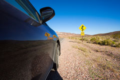 Close-up of car on the road in desert, California Stock Photo