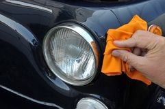 Clean a car with a cloth royalty free stock photography