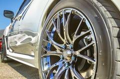 Close up of a car& x27;s rim, wheel with no emblem chrome rims and bl Royalty Free Stock Photos