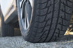 Close up of car`s winter tyre tread on the gravel road Stock Images