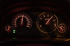 Close up of a car speedometer. Image of a modern speedometer shows rpm number in high speed Royalty Free Stock Photos