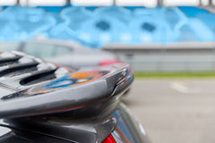 Close up of car spoiler on speedway at stadium Stock Photo