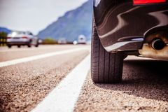 Car is standing on the breakdown lane, asphalt and tyre, Italy. Close up of a car standing on a breakdown lane, summer vacation, tyre, broken, wheel, highway stock photo