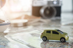 Close-up a car on table with a map with a paper ompass Royalty Free Stock Photos