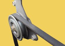 Close up of car timing belt and pulley. stock photo