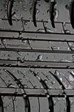 Close-up of car tire with with water drops Royalty Free Stock Images