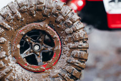 Close-up of car tires in dirt road stock image
