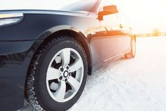 Close up of car tires on the winter road Royalty Free Stock Image
