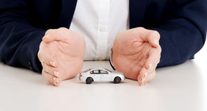 Close up on car toy model between hands. Royalty Free Stock Photography