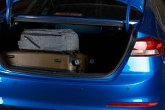 Close-up of car trunk with bags Royalty Free Stock Photo