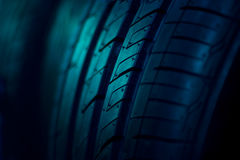 Close up car tyre on dark background Royalty Free Stock Image