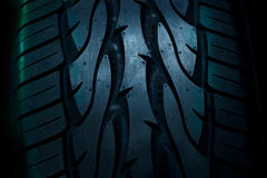 Close up car tyre on dark background Royalty Free Stock Photo