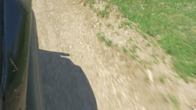Close-up of a car wheel on a countryside road stock video