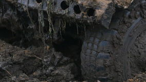 Close-up of a car wheel stuck in the dirty water and mud. Wheel is spinning, but it helpless. Close-up of a car wheel stuck in the mud. Wheel is spinning, but it stock video footage