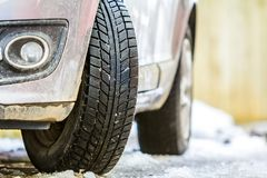 Close-up of car wheel in winter tire on snowy road Royalty Free Stock Image