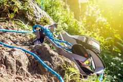 Close-up carabiner and climbing rope near rock stock photography