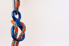 Close up of carabiner and figure 8. With climbing rope Royalty Free Stock Photography