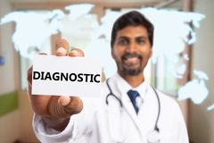 Close-up of card with diagnostic text held by medic. Close-up of white card with diagnostic text held by indian male medic on blue world map background royalty free stock photo
