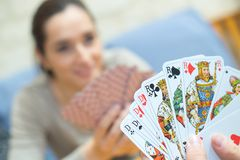 Close up card game in hands. Close royalty free stock images