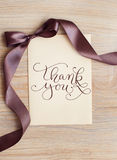 Close up of card note with brown ribbon and words thank you Royalty Free Stock Photo