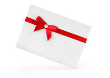 Close up of card note with red ribbon on white background with c Stock Photo
