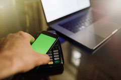 Close up of a card payment being made betweem a man and a waiter royalty free stock photo