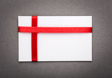 Close up of card with red ribbon bow Royalty Free Stock Photography