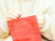 Close up card with woman needling the home made fabric decoration royalty free stock photo