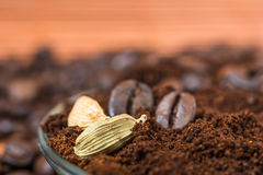 Close up of  cardamom with ground coffee heap. Selective focus. Royalty Free Stock Photography