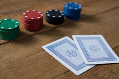 Close-up of cards and chips on wooden table Royalty Free Stock Photo