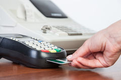 Close-up of cards servicing with POS-terminal Stock Images