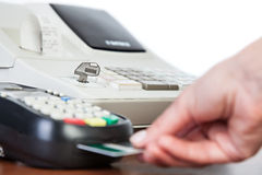 Close-up of cards servicing with POS-terminal Royalty Free Stock Photos