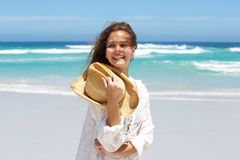 Close up carefree young woman smiling at the beach Royalty Free Stock Image