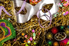 Close-up of carnival masks and parties on confetti royalty free stock images