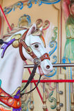 Close-up of carousel horses for children amusement in France Royalty Free Stock Photo