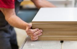Close up of carpenter with boards at factory Royalty Free Stock Image