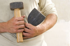 Close up of carpenter holding mallet and chisel Royalty Free Stock Photos