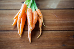 Close up of carrot bunch on wooden table Royalty Free Stock Photography
