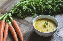 Close-up of carrot and turmeric soup on wooden table Royalty Free Stock Image