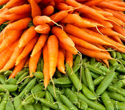Close-up Carrots and pea pods Stock Photos