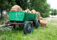 Cart with velour grasses or stover. Close up of the cart with the velour grasses or stover with the green color in the background Stock Photography