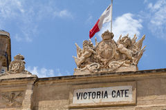 Close up of carvings on Victoria Gate, Valletta, Malta. English Royal crest stone carving seen above Victoria Gate, at the entrance of Valletta from the Grand Stock Photos