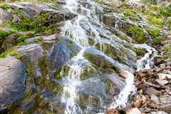 Close-up cascade mountain waterfall in the green mountainside. royalty free stock images