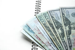 Close-up cash on blank note book Royalty Free Stock Photography