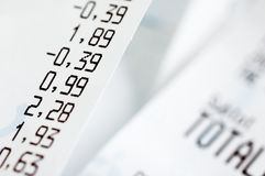 Close-up of cash register receipts stock photography