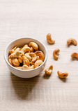 Close up cashew nuts on wooden background Royalty Free Stock Photos